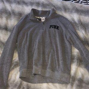 pink zip up sweatshirt